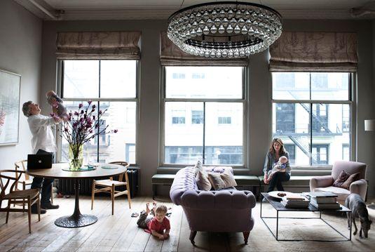 Amazing. Love the light, chandelier and industrial feminine loft feel.