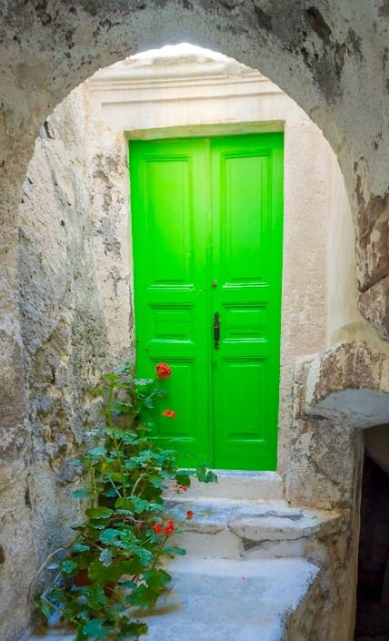 """Emporio, Santorini, Greece    The bright green, as well as the overhead light, just make this a perfect """"welcome home!"""""""