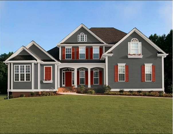 Accent colors for the exterior of your home dark gray siding red door red shutters new - Dark grey exterior house paint concept ...