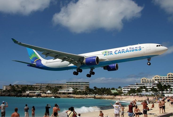 Air Caraïbes Airbus A330-300 flying over Maho Beach shortly before touch-down