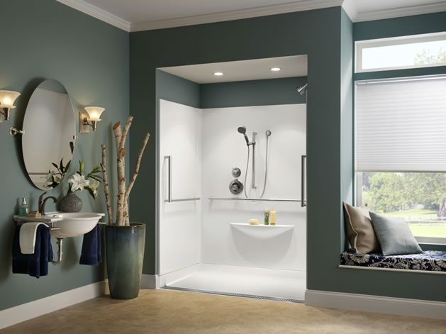 Trench drain creates a beautiful way to make a no-step shower for universal design without looking like a roll in shower. They can also be placed in the middle or back of the shower, and come in many styles.