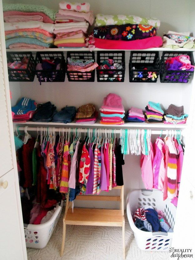Milk crates hung from a shelf can double your storage space. | 21 Actually Useful Things You Didn't Know Your Closet Needed