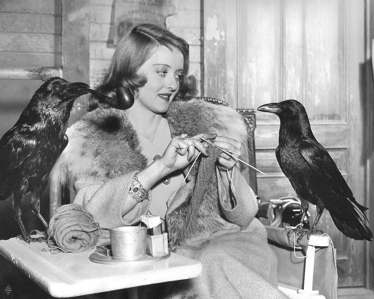 Bette Davis, knitting. With a raven.