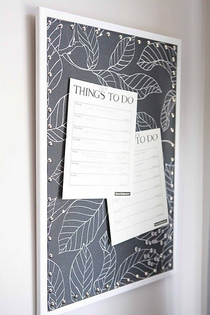 A dressed corkboard is more beautiful than a naked corkboard.   I saw another idea where they first secured the fabric with a spray adhesive. Nice.