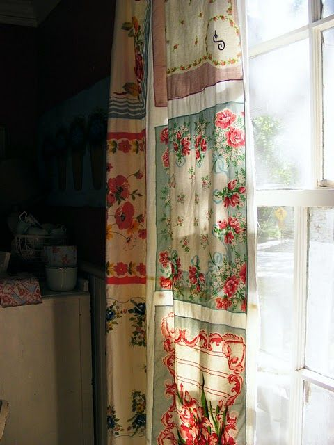 Vintage hanky curtains, found this image here on pinterest, but saw the idea in Vintage Style Magazine! Thinking maybe for my kitchen, if I can find enough hankys! You sew them together on top of a white cotton sheet.