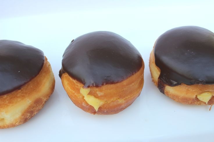 Cream-Filled Doughnuts - yeast-raised doughnuts filled with vanilla pastry cream and dipped in chocolate glaze