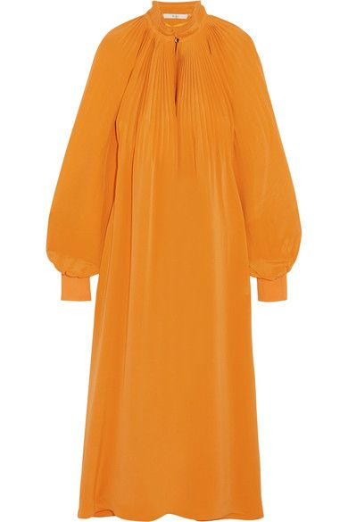 Tibi's dress is made from billowing silk crepe de chine in a saffron hue - striking colors are a defining feature of the label's Spring '17 collection. The raised neckline, plissé shoulders and voluminous bishop sleeves add to its Edwardian feel. Mimic the runway styling with a single statement earring and sandals.