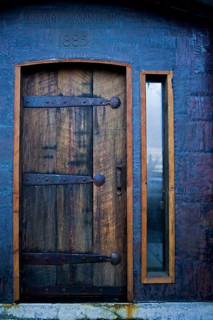 Iron Hinges on an old door. The straps across give essential support to the door.