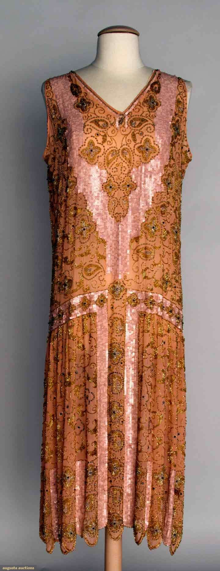 "BEADED SILK CHIFFON DRESS, 1920s Peach chiffon, scalloped hem, gold & crystal beading w/ irridescent pink sequins, B 38.5"", W 38"", L 45"", (minor bead loss) excellent."