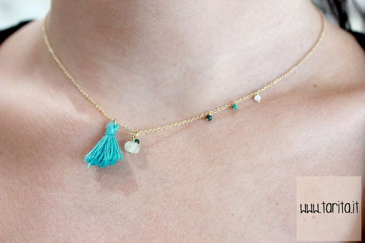 "Tarita, ""5 Octobre"". COLLIER MO: tiny and delicate necklace made of brass gilded with 24 carats gold, agate and a small tassel. Available in turquoise (pictured), fucsia and black."