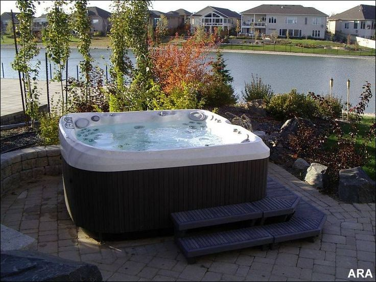 Hot Tub In Backyard Ideas this version is built into a raised stone garden bed and is covered by a curved Find This Pin And More On Backyard Spa Ideas 8 Ways To Place Your Original Outdoor Jacuzzi