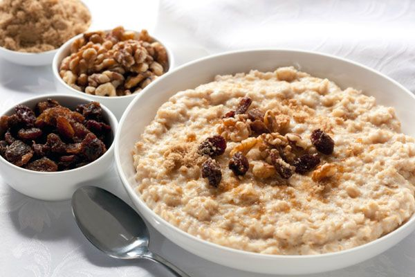 "9 Foods That Help You Lose Weight: Oatmeal Topped With Walnuts ""Carbs give you energy and the nuts delay the release of that energy so your blood sugar remains stable."""