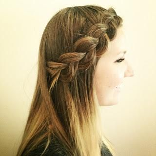 Deep side part and inverted braid.