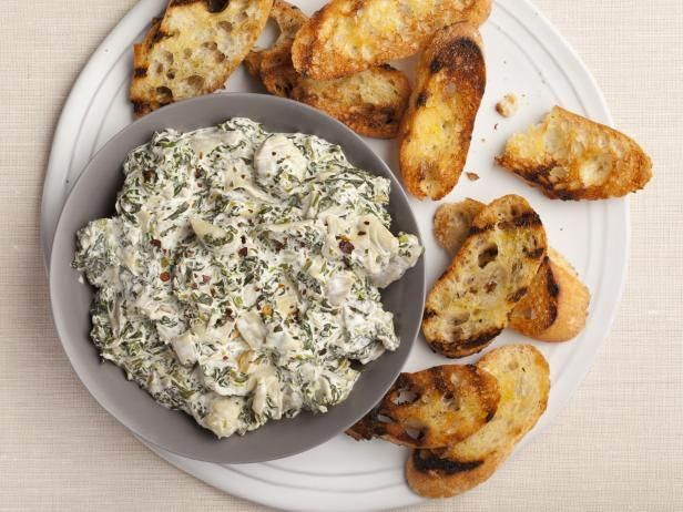 Best Thanksgiving Appetizer Recipes: Alton's Hot Spinach and Artichoke Dip  Get more easy Thanksgiving appetizer recipes from Food Network, including deviled eggs, butternut squash soup and stuffed mushrooms.  #Thanksgiving #ThanksgivingFeast