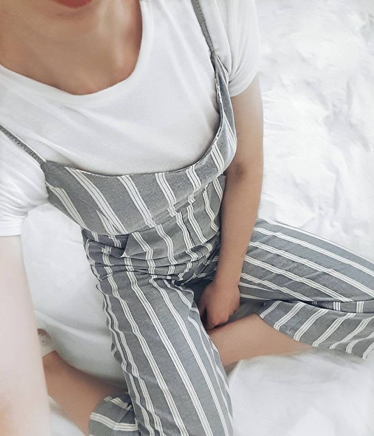 Spring outfit idea: white t-shirt layered under jumpsuit