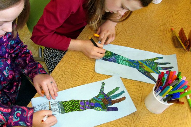 """This is one of my all-time favorite art and writing projects used to help celebrate the teachings of Dr. Martin Luther King, Junior. After tracing their hands and part of the forearm onto light blue paper, students fill the piece with pen and ink designs. Cool colors are added with fine markers. Poetry beginning with the words, """"Peace is in my hands"""" then flows around the outline."""