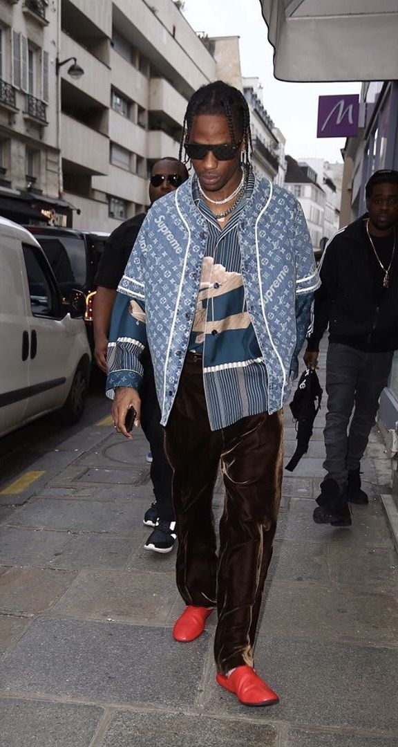 Travis Scott Wears Louis Vuitton x Supreme Shirt Over Another LV Shirt and Pants in Paris  |  UpscaleHype