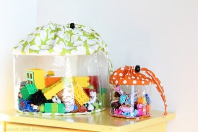 DIY vinyl cinch-up storage bags - so smart!!! It took a bit of clicking to find the right page, so here's the link:  http://www.makeit-loveit.com/2011/12/clear-toy-storage-bags-with-drawstring-closure.html