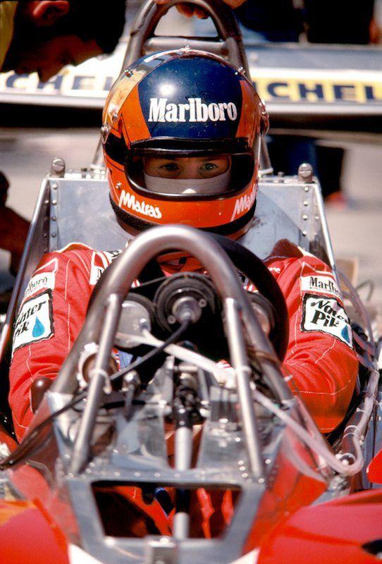 Ferrari driver Gilles Villeneuve waits out last minute adjustments to his Ferrari 312 T3.