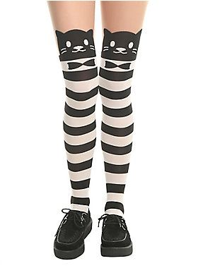"<div>The cats on these faux thigh-high tights are here to help you dress up. They put on their tuxedos and are ready for your night out. The black and white striped tights are topped with black cat faces and a sheer thigh, so it looks like you're wearing thigh highs but are way more comfortable.  </div><div><ul><li style=""list-style-position: inside !important; list-style-type: disc !important"">One size fits most</li>&l..."