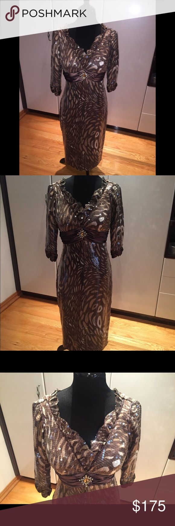 "Brown Animal print Sequin Elegant Evening Dress 6 Beautiful Brown Sequin Animal 🦓 print Elegant Evening Dress in size 6. Fully lined. Had some alterations done: Shortened length, added on 3/4 sleeves and ruffles.  Measurements: Length about 43"" Annabelle Dresses Wedding"