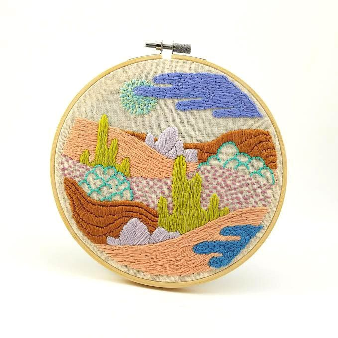 Hand stitched embroidery of a fantastical landscape of rolling hills and mysterious plant life. Made with DMC embroidery floss in a 6 inch bamboo hoop, which serves as a frame. Perfect addition to you