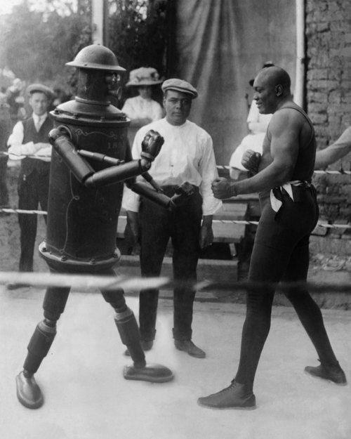 """Jack Johnson battles the Victorian-era robot ""Boilerplate."", c 1910's"""