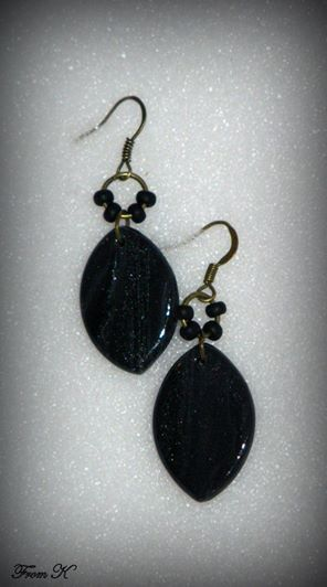 """Ellips drop earrings. Incredibly lightweight and elegant polymer clay beads -- Easy and convenient wear. Because each piece is handmade, every piece is completely unique and carries its own """"flaws"""" making it one-of-a-kind. Have been sanded, buffed and sealed for a silky smooth finish and supplemented with Czech seed beads. About 4 cm long with ear piece. 9.00 Ron"""