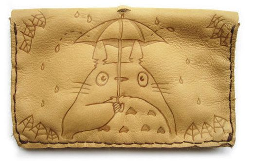 Handmade leather tobacco pouch totoro with umbrella    #chibipyro #artisan #craft #shop #leather #wood #woodburning #fire #fan #art #artisan #craft #handmade #etsy #shop #pyro #pyrography #burn #burning #fire #drawing #woodburner #cork #recycled #purse #comb #hairbrush #note #book #sketch #tobacco #pouch #bookmark #pochette #box #pencil #case