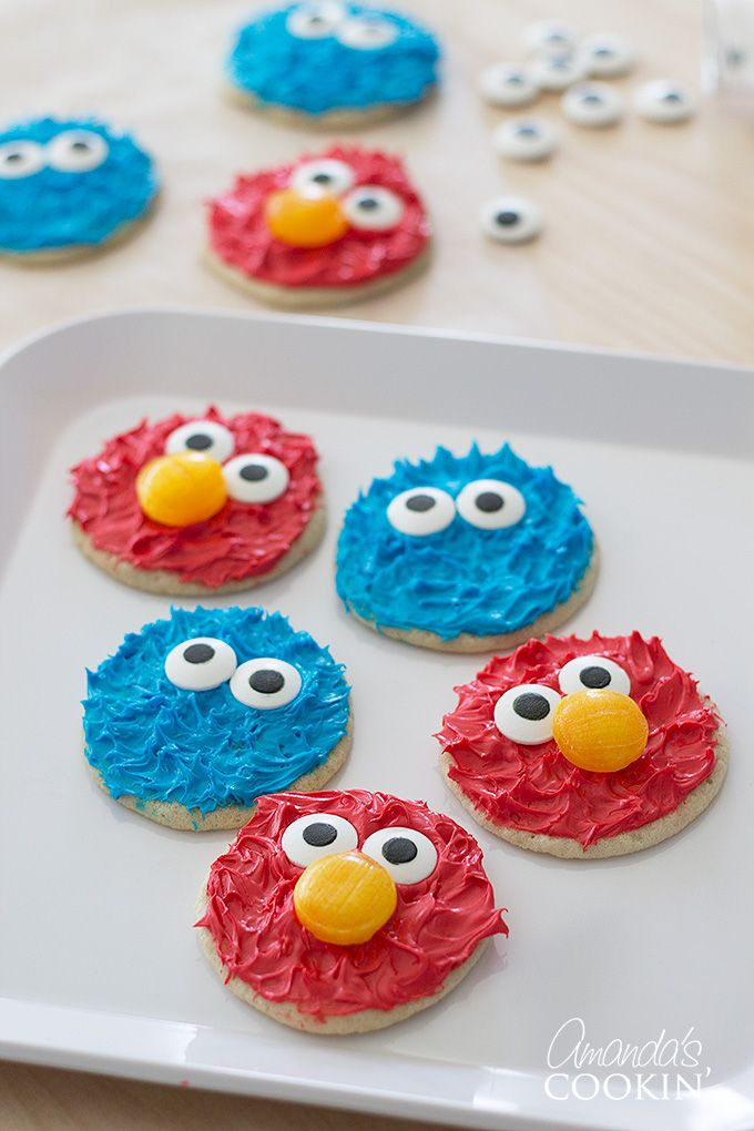 Oh my gosh, Cookie Monster and Elmo cookies! How can you resist the cuteness! I know, you can't. Neither could I! That's why I just had to make them. After all, Cookie Monster and Elmo were both a big part of my childhood, and I can't resist adorable edibles. These Cookie Monster and Elmo cookies would be perfect for a Sesame Street themed birthday party too!