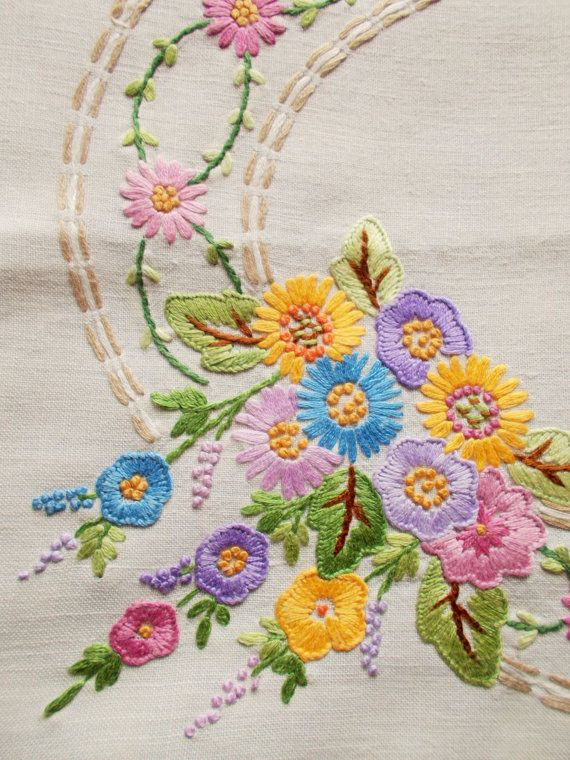 Beautiful vintage hand embroidered tray cloth flowers in an