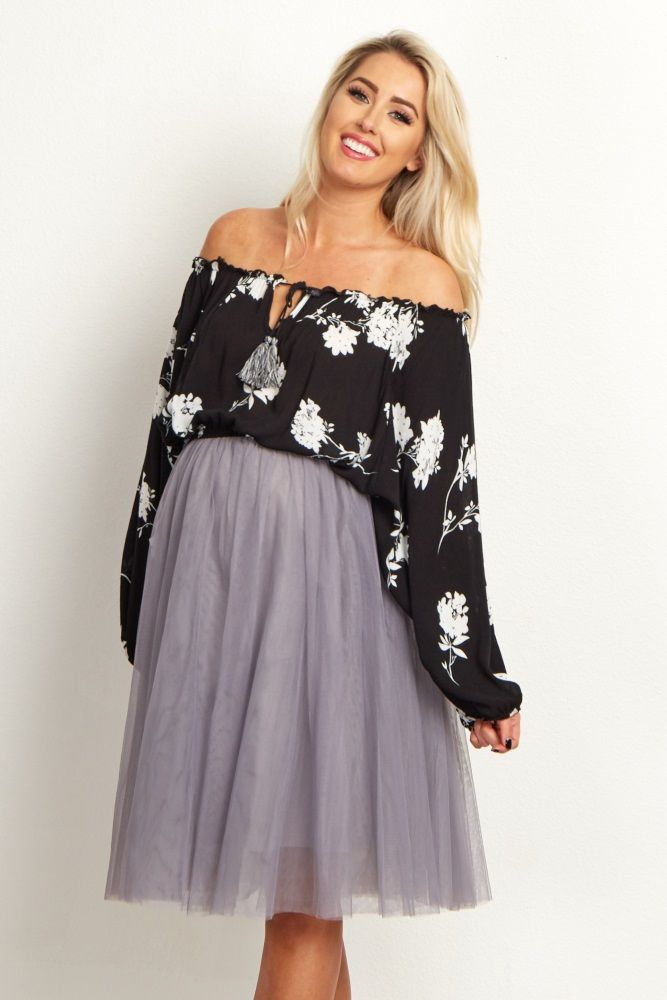 Get in touch with one of the hottest styles this season with this maternity crop top. A cinched neckline lets you wear this top on or off your shoulders, and oversized sleeves give you a trendy boho style. Wear this top with a solid high waisted skirt or flared maternity pants for a complete ensemble.