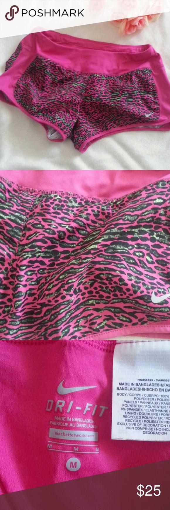 "Nike Dri-Fit Running Shorts Medium Excellent condition  Size medium Pink leopard style Waist 30"" Inseam 2.5"" Nike Shorts"