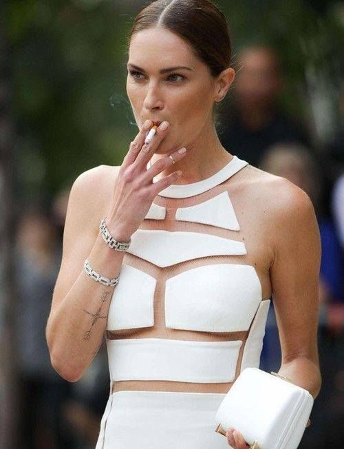 how nice, wearing a couture alexander wang gown and making it smell like cigarettes, classy.