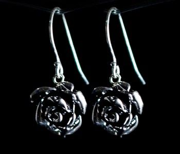 Set on sterling silver hooks, these pretty antique rose earrings are perfect to wear for any occasion. Available in silver (pictured) or black.
