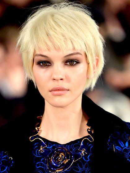 Short, choppy hair and dramatic gray-brown eye mak