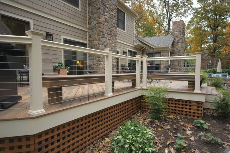modern deck idea with stainless steel cable railing and white concrete rail posts cedar lattice house skirting in square shape cedar deck floors of Raised House Skirting: Smart Solution for Hiding Piers and Dirt in Aesthetic Way