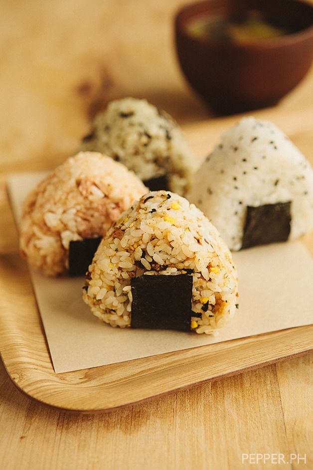Assorted Onigiri by Pepper.Ph. It's safe to say that Onigiri has, more often than not, a permanent seat in Japanese bento boxes. These delightful little sushi-rice balls have the capacity to not only make your lunch seem very cutesy-AZN, but also very convenient. It's perfect if you're the kind of person who has meetings every hour, and the only utensils available are your two bare hands.