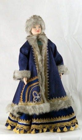 A doll in the traditional winter costume from Vologda Province, Russia. Fashion of the 19-th century.