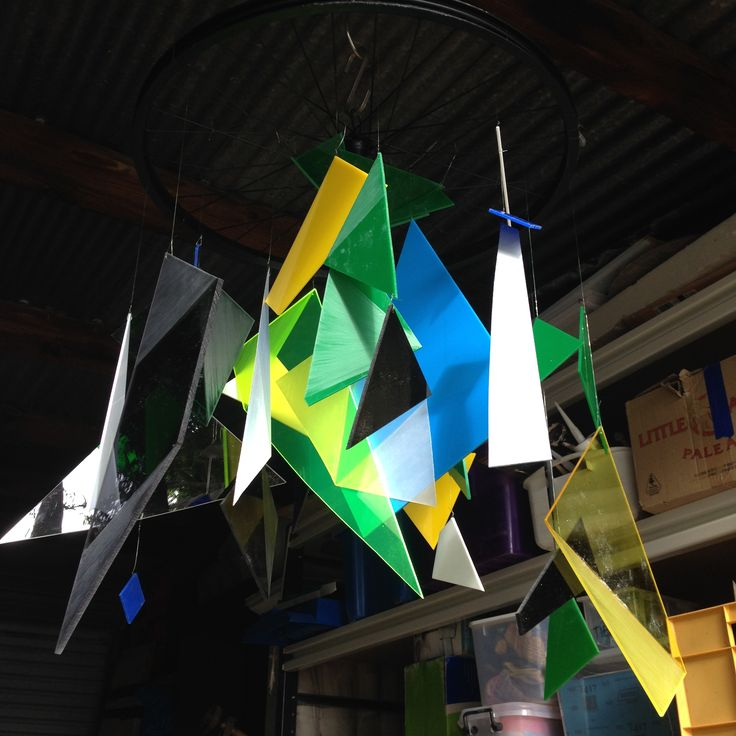 """60th decorations - hanging feature.  Client had a blue/green geometric invite and said """"nothing cheesy, no balloons, no gold or silver."""""""