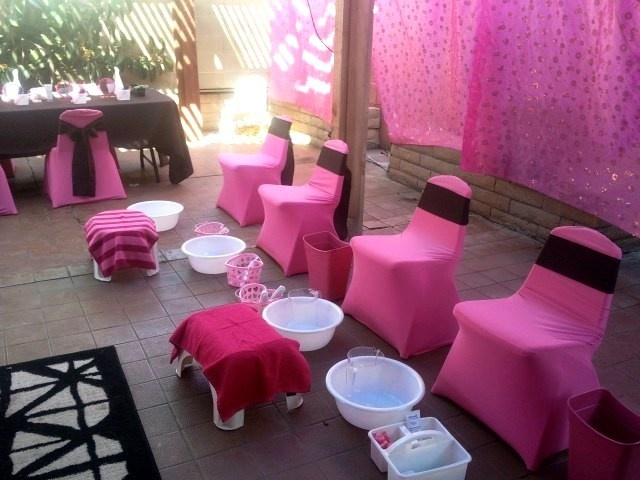 spa party set up, spa party pedicure station, spa party decorations, spa party activities, kids spa party robes, kids sized tables and chairs with custom chair covers, kids party rental, www.themesforkidspartyrental.com in Orange County, Costa Mesa, California