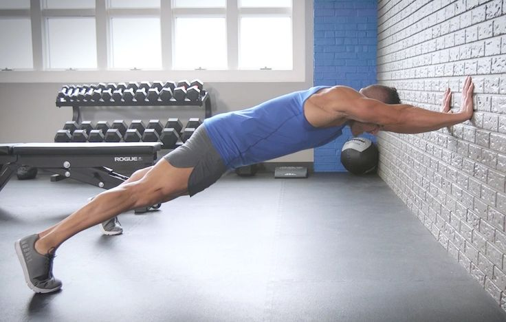 The Men's Health Fitness Director shows you how to do the ab-screaming wall pushup walkup