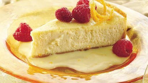 Luscious Orange Cheesecake with Raspberries Recipe | Yummly