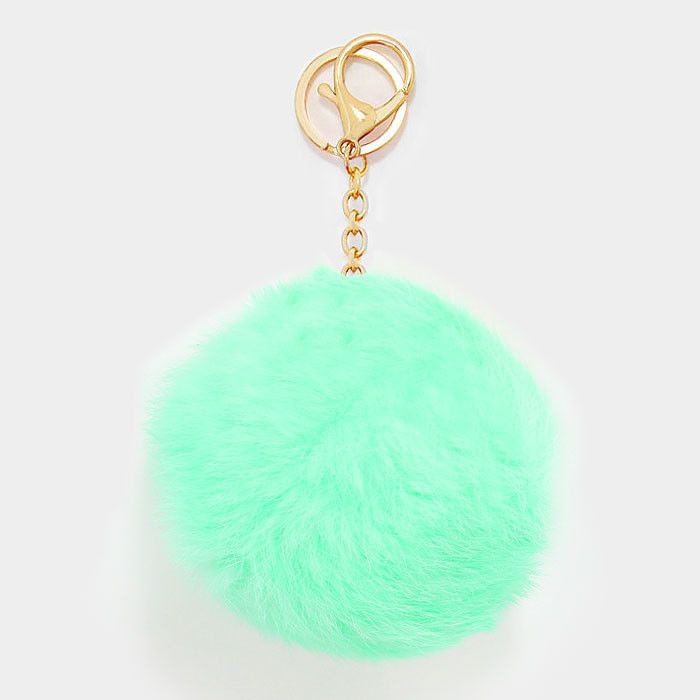 """New for Spring! These season's hottest accessory for your bag - a large fur pom pom keychain in mint! Pom Pom is 4.5"""" X 5.5""""."""