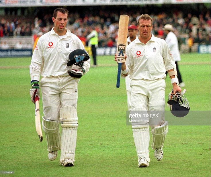 Alec Stewart (right) and Marcus Trescothick (left) of England leave the field during the second day of the England v West Indies Third Cornhill Test Match at Old Trafford, Manchester. Mandatory Credit: Michael Steele/ALLSPORT