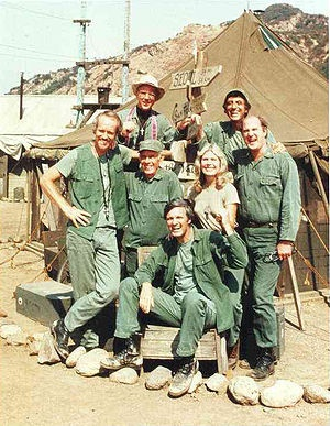 The innovative 80's TV show M*A*S*H. was based on the 1968 novel M*A*S*H by Richard Hooker. This 80's drama was a household favorite. The TV series M*A*S*H was set near Seoul, South Korea during the Korean War. The plots centered on the group of doctors and nurses whose job was to tend to the wounded who arrived at the unit.