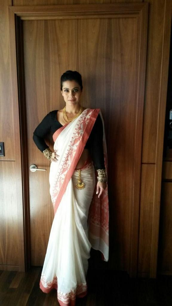 Kajol in a white saree or sari and black blouse
