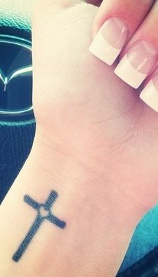 wrist tattoo  #tattoo #wrist #girls  www.loveitsomuch.com i probably would just get the cross but you get the picture! So cute!