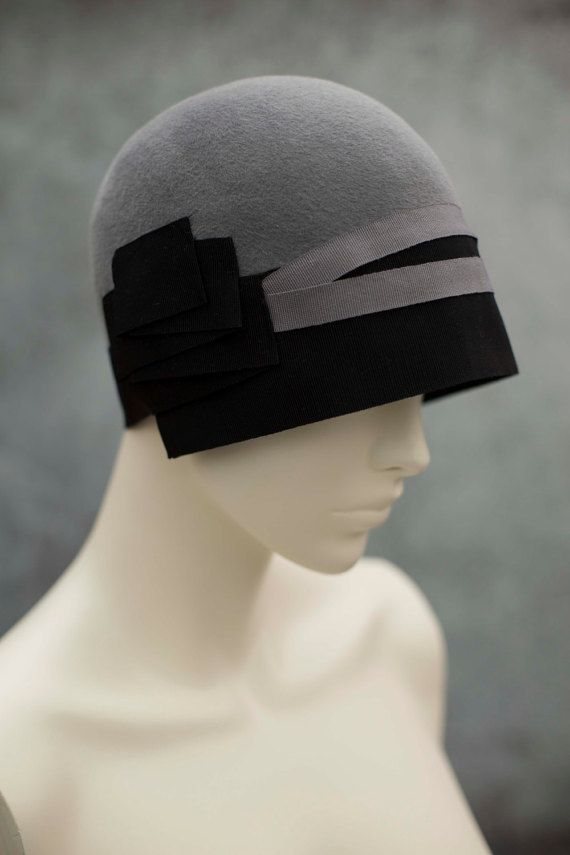 A fabulous close fitting felt cloche hat made from rich velour felt and finished with hand pleated ribbon detailing, team with a wool coat or a