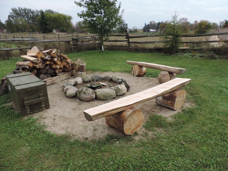 Diy fire pit benches from cedar ripped with a chainsaw and balanced on two cedar chunks Fire pit benches